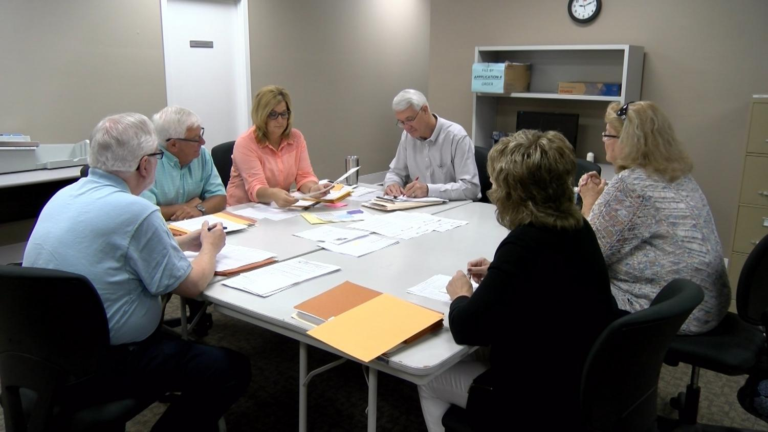 Members of the Muskingum County Board of Elections verify votes from the 2018 primary election