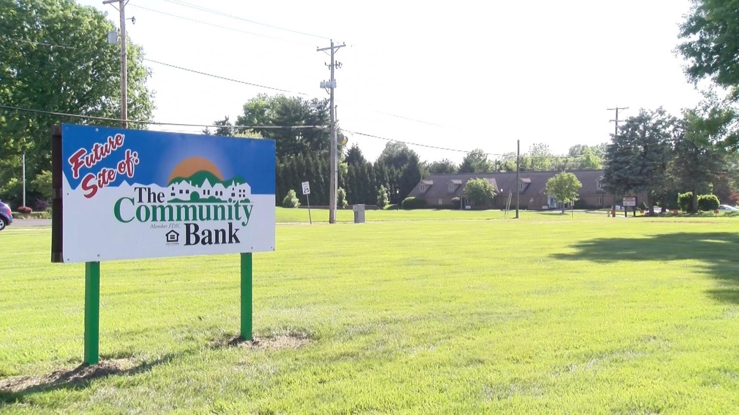 A sign marks the location of the new Newark branch of the Community Bank