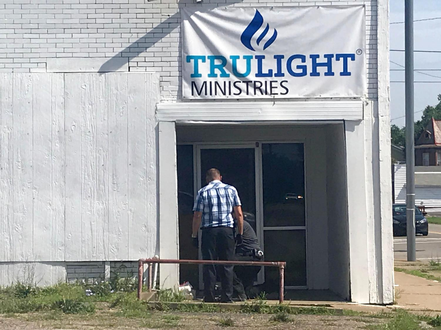 Police detectives investigate fatal stabbing. The detectives were seen collecting evidence in the doorway of Trulight Ministries on Putnam Avenue.