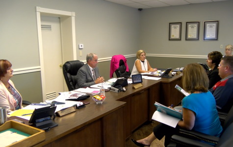 CORSA hands commissioners $16,204 check
