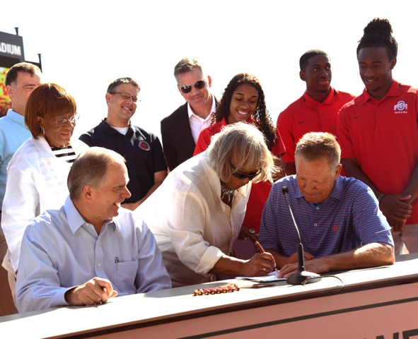 Jesse Owens daughter, Marlene Owens Rankin, dots the Is on the physical agreement between the State of Ohio and AEP.