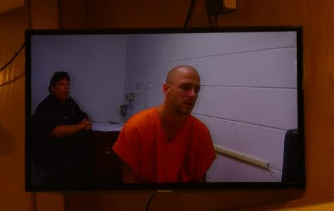 Man charged in stabbing death appears before judge in tears