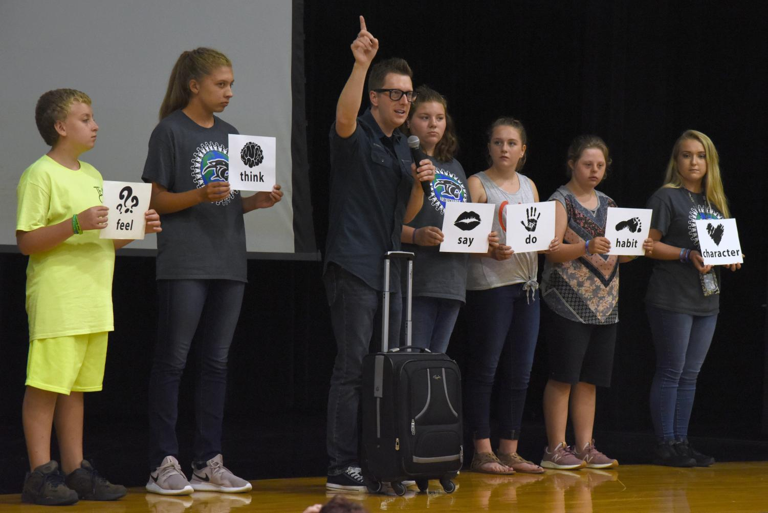 Tom Thelen demonstrates ways to combat bullying using the help of students.