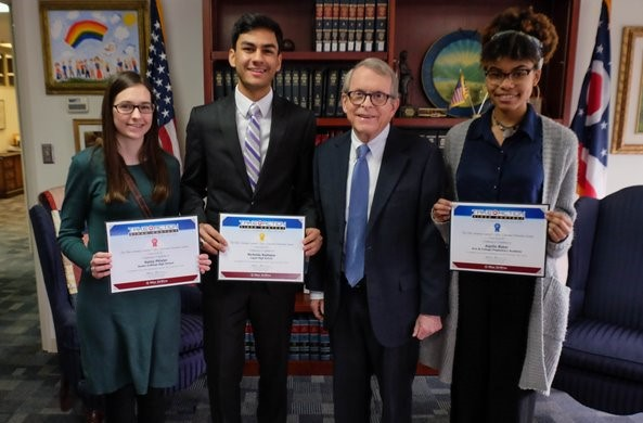 Mike DeWine poses with the top three winners of the 2017 Take Action Scholarship Contest. Photo from the Ohio Attorney General's website.