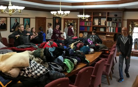 Donated coats from the 2017 annual coat drive are displayed on a large table. Photo provided by Christy Rahrig, Advisor with the Community Youth Foundation.