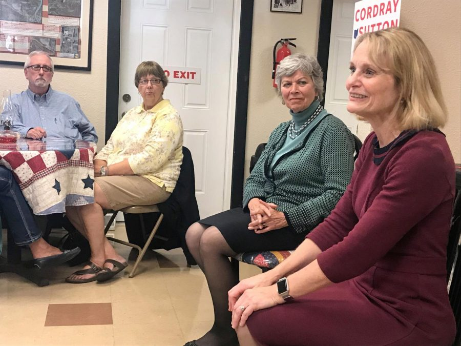 Frances Strickland, left, and Peggy Cordray, right, converse with the crowd gathered at the Nelson T. Gant Foundation in Zanesville during the first stop of the