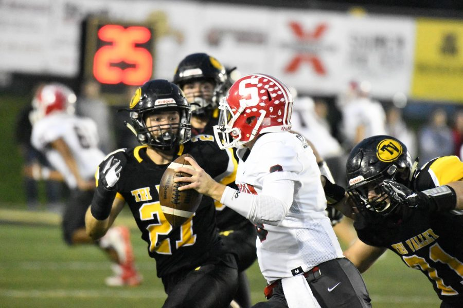 Sheridan's Ethan Heller is chased down by Tri-Valley defenders Garrett French and Blake Kendrick during the Scotties 20-19 victory over the Generals in Dresden Friday night.