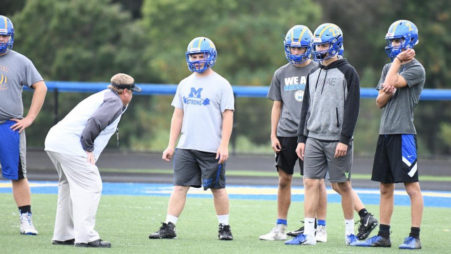 Maysville coach Craig Clarke talks to some of his players during Thursday evening walkthroughs.