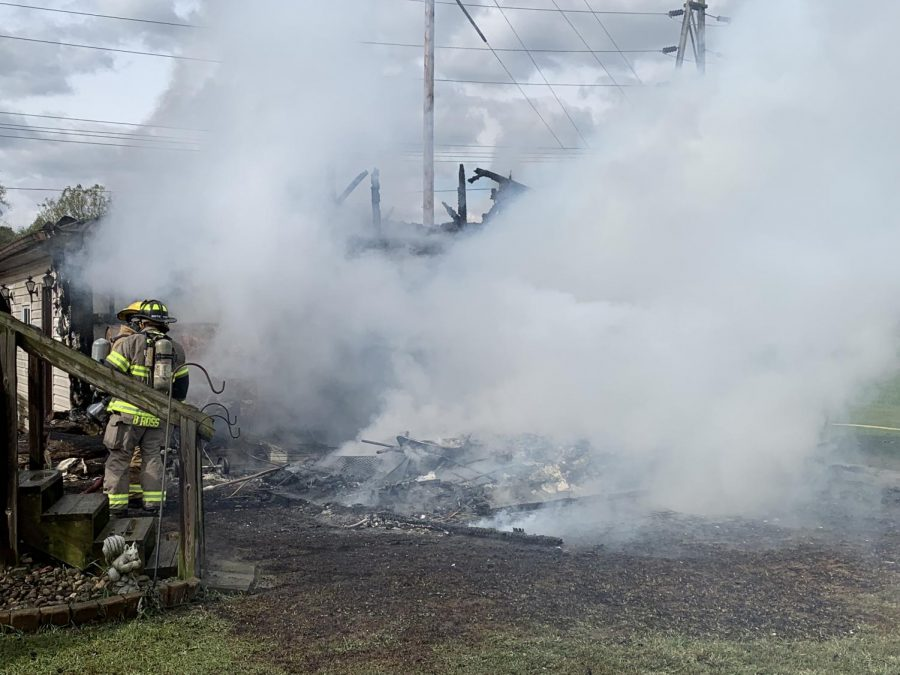 Firefighters+work+to+extinguish+the+flames+from+a+detached+garage+fire+at+the+intersection+of+Elm+Street+and+3rd+Street.