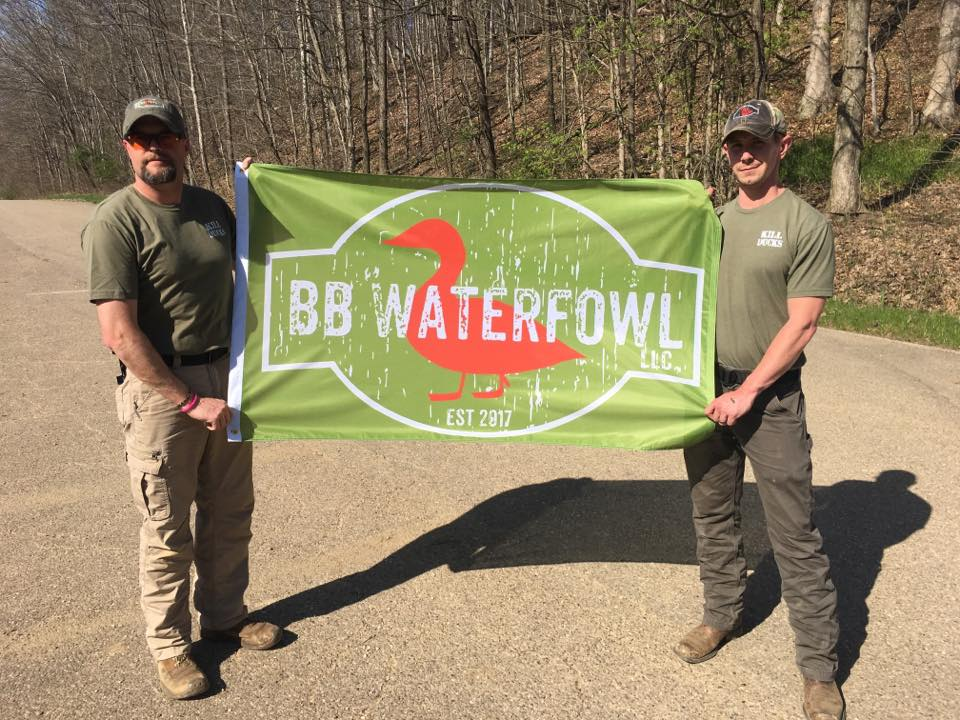 Bill Brooks, left, and Brandon Rexroad, right, hold out a BB Waterfowl sign with the company's logo. Photo provided by BB Waterfowl.