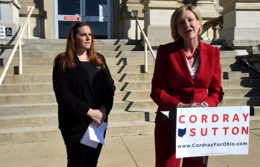 Betty Sutton (right) speaks outside the Muskingum County Courthouse Tuesday morning accompanied by Amber Daniels (left).