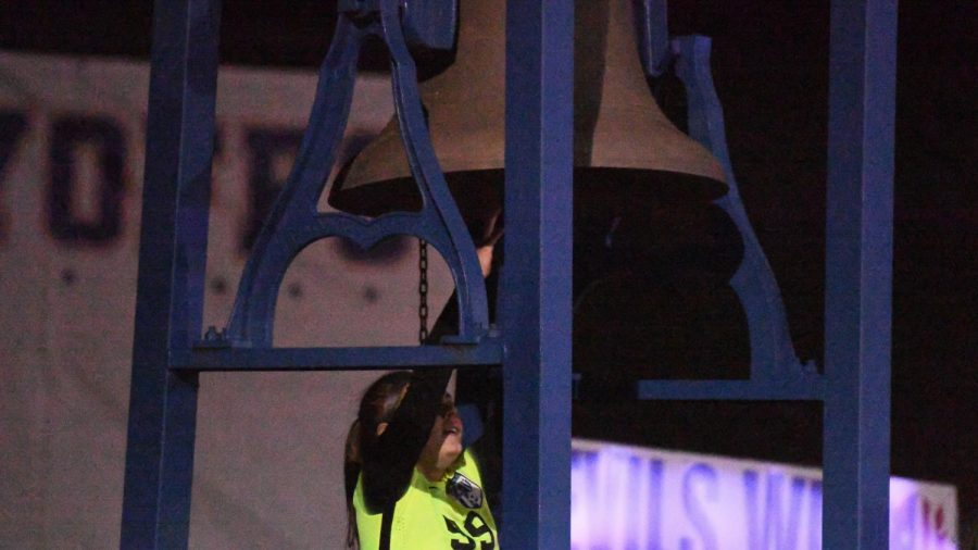 Zanesville goalie Rhyle Antonentz rings the victory bell at Sulsberger Stadium following a sectionals win over Tri-Valley Wednesday night.