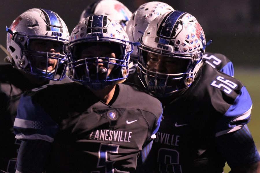 Senior+offensive+lineman+Jeremiah+Hollins+%28right%29+and+junior+running+back+Gaige+Barnett+%28left%29+celebrate+with+senior+running+back+JC+Curtis+%28center%29+following+a+touchdown+in+the+Blue+Devils+41-7+win+over+Marietta.