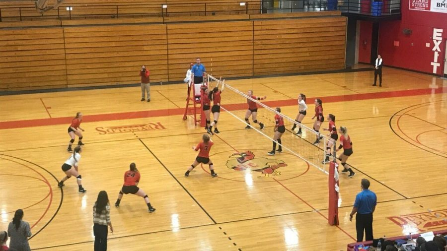 The Muskingum womens volleyabll team looks to defend against an Otterbein scoring attempt in an OAC tournament semi-final matchup.