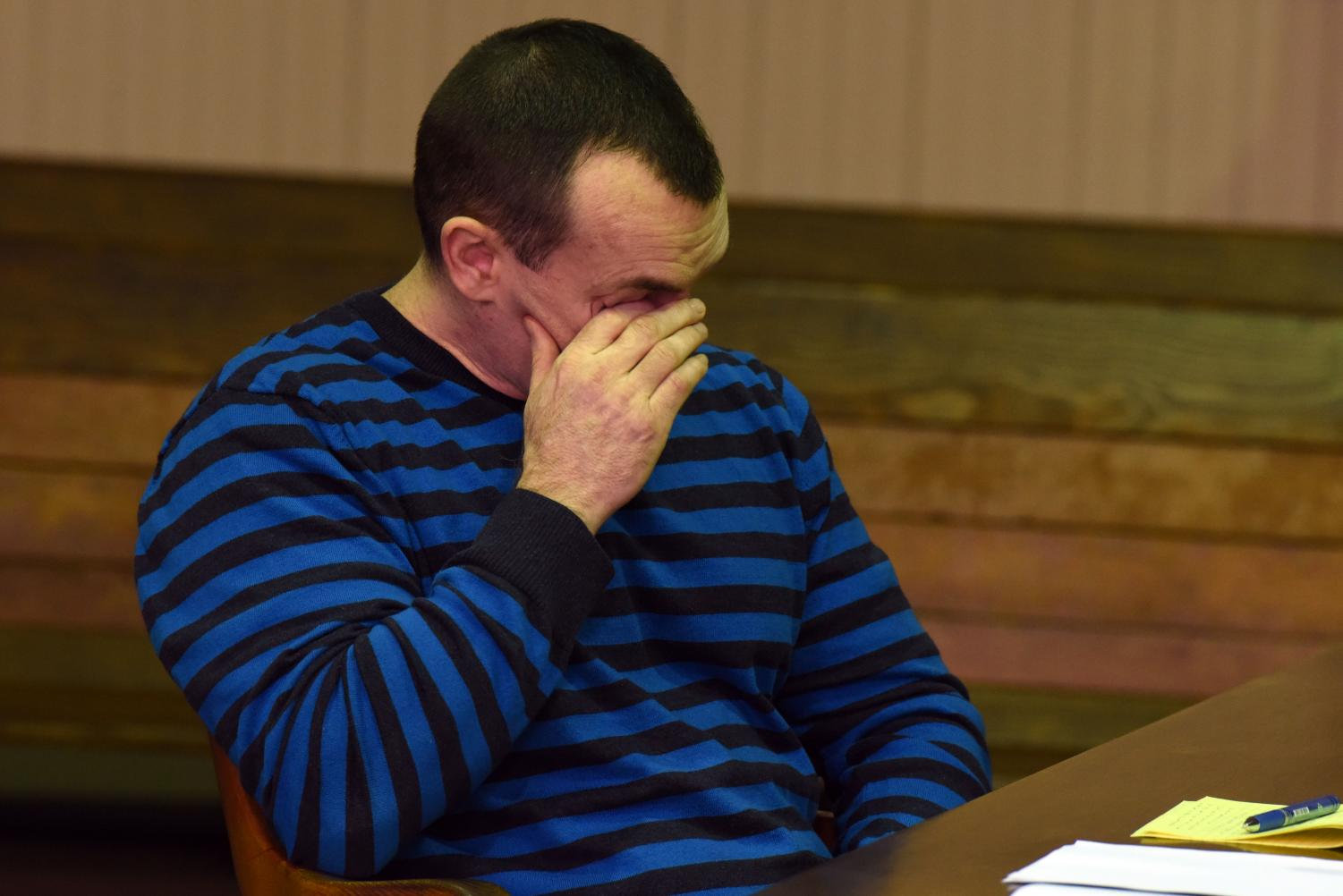 John J. Iden, Jr. becomes emotional while his defense attorney, Jeff Blosser, presents his closing statement on Monday.