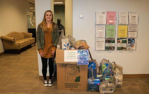 Kassie Settles, a member of the Ohio University Student Social Work Association, led the first phase of the drive to collect product for the Transitions Shelter. Photo provided by Holly Voltz.