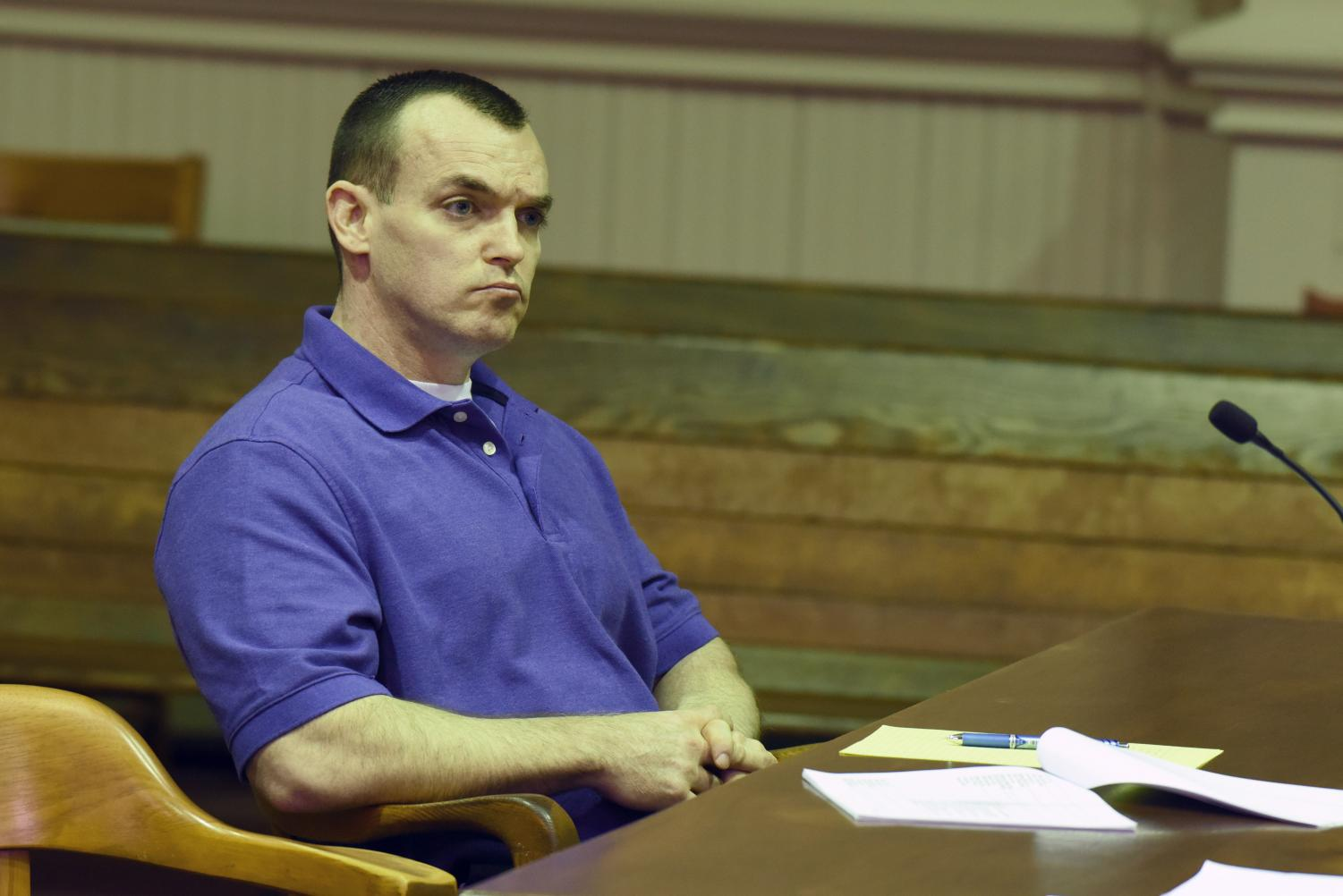 Defendant John Iden listens to a witnesses during cross-examination Wednesday afternoon.