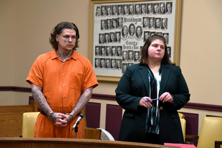 John+Hampton+stands+beside+his+defense+attorney%2C+Kendra+Kinney%2C+for+his+sentencing+on+Jan.+17.