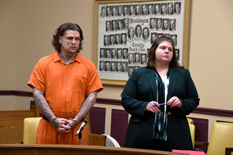 John Hampton stands beside his defense attorney, Kendra Kinney, for his sentencing on Jan. 17.