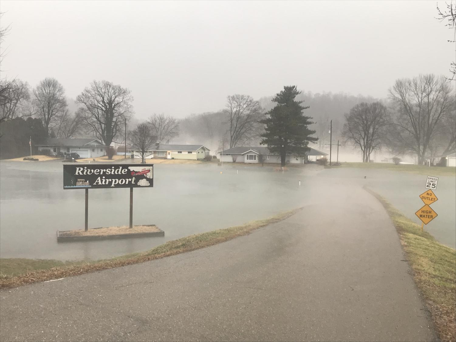 Riverside Airport Road, the main road into Riverside Airport, is completely under water as of Tuesday afternoon.