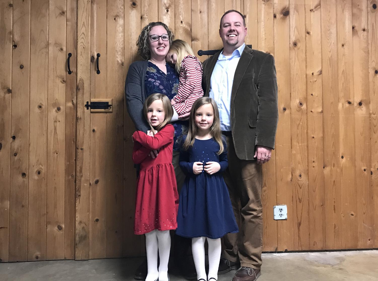 Kristi (KJ) Kearns poses for a photo with her husband and their three daughters following her first meeting as a member of the New Concord Village Council on Feb. 11.