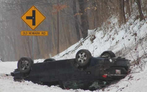 Woman injured in Newark Road rollover