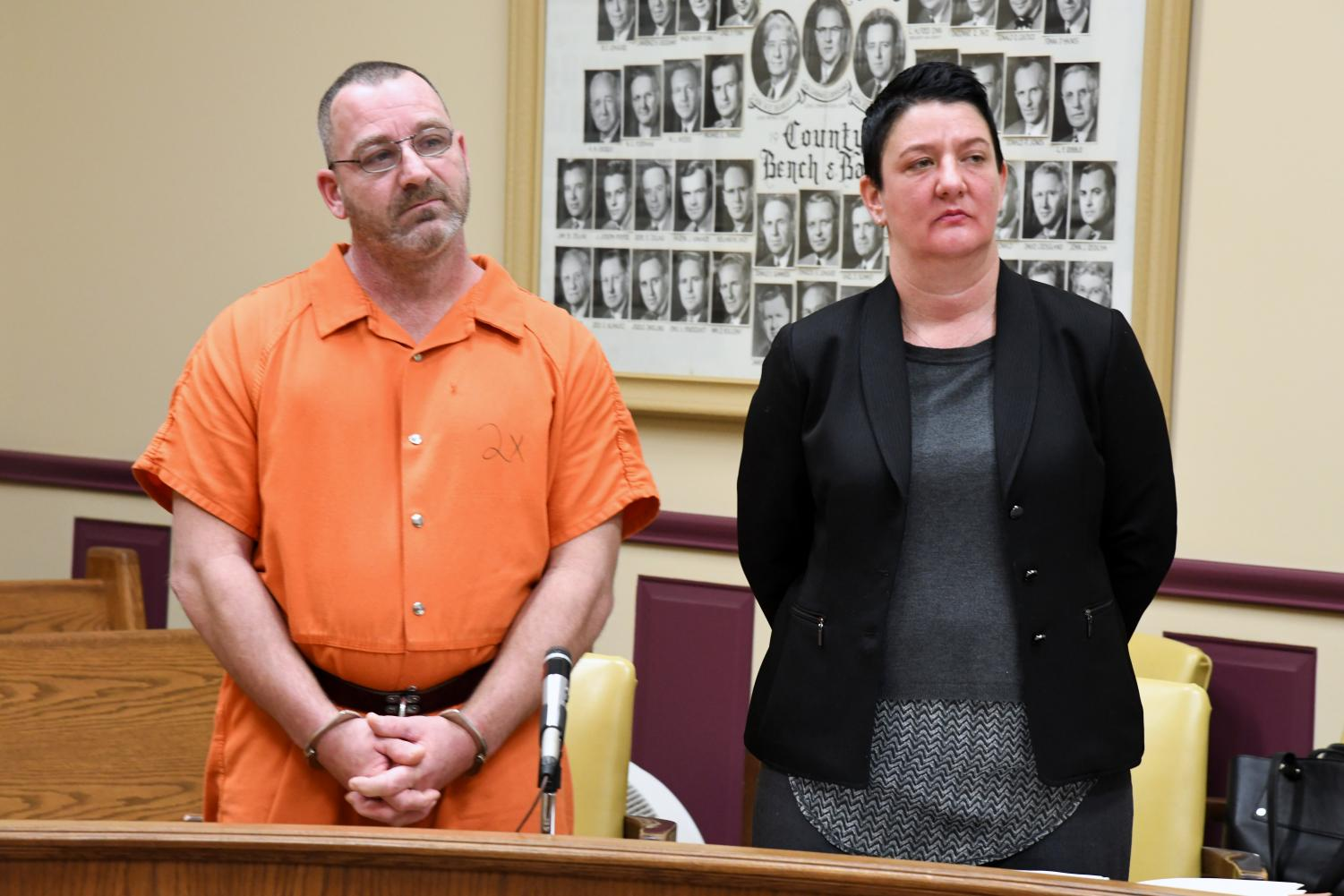 Travis Pletcher (left) stands with his defense attorney Nicole Churchill (right) in the Muskingum County Court of Common Pleas to reverse his former plea of not guilty.