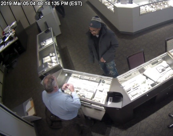 The man accused of stealing merchandise from Kay's Jeweler is seen on camera while inside the store. Photos provided by the Zanesville Police Department.