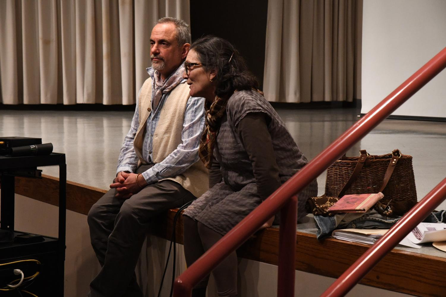Maddy Fraioli and her husband Howard Peller field questions from the audience at the John McIntire Library Tuesday evening following their ceramics incubator presentation.