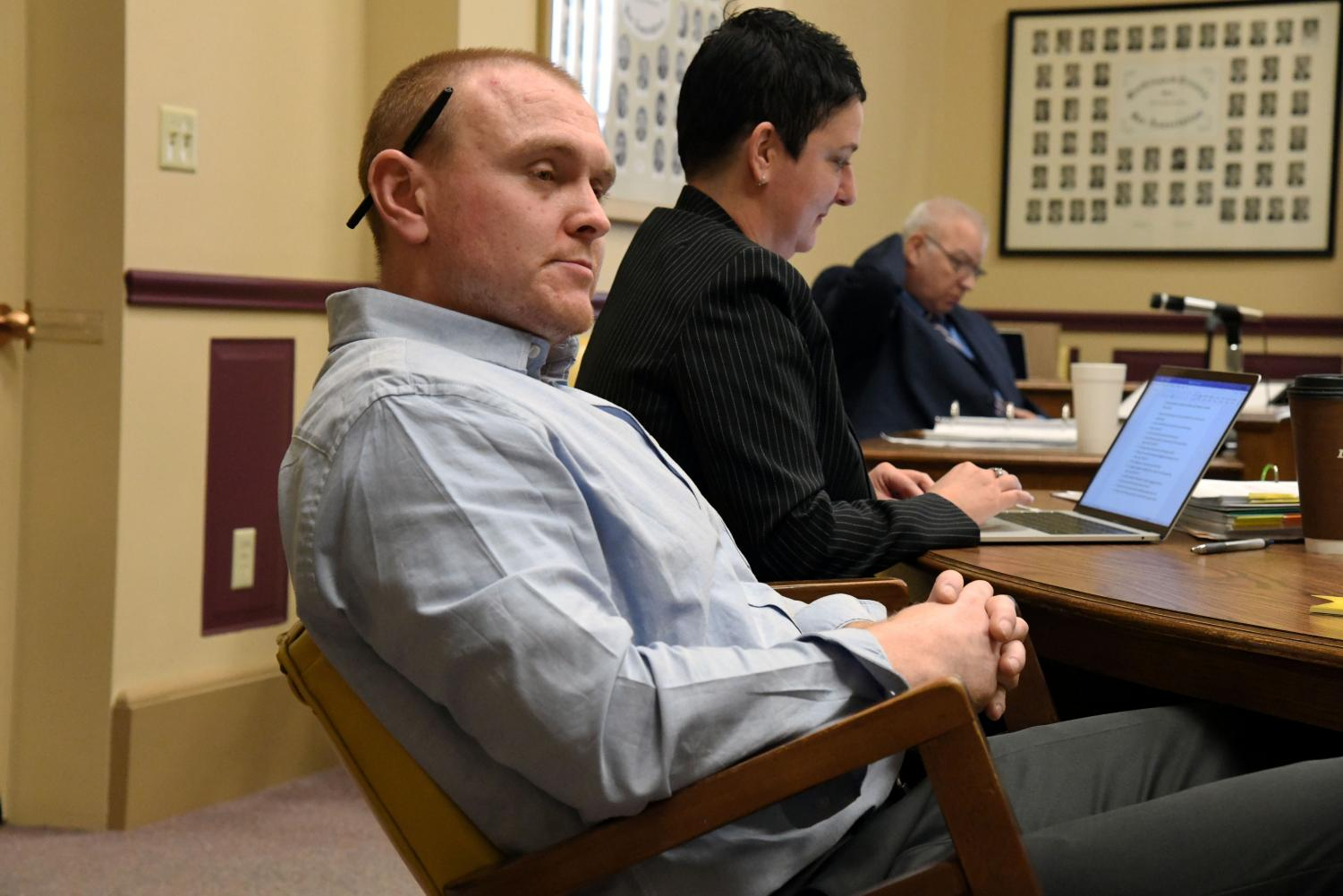 Joseph Hodge listens to Assistant Prosecuting Attorney John Litle as he questions a witness Wednesday.