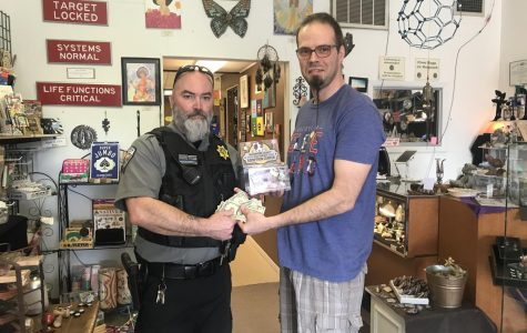 Local business supports dog warden through donation box matching program