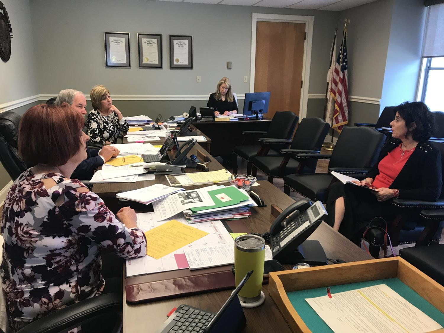 Danielle Mason, Eastern Regional Director for the Ohio Attorney General's Office, meets with the Muskingum County Commissioners Thursday morning.