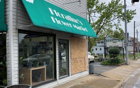 Police investigating broken storefront window on Maple Avenue