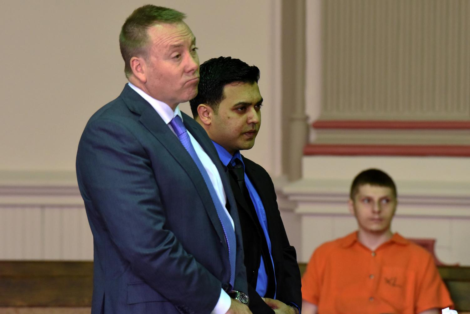 Rizwan Lahuti stands but his attorney Brad Kofel while Judge Kelly Cottrill hands down Lahuti's sentence.