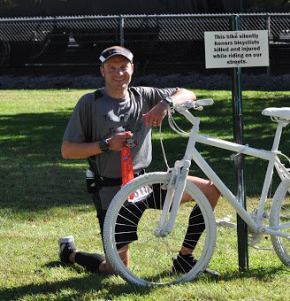 Brad Hollingsworth with the Ghost Bike | photo provided by Zane State College