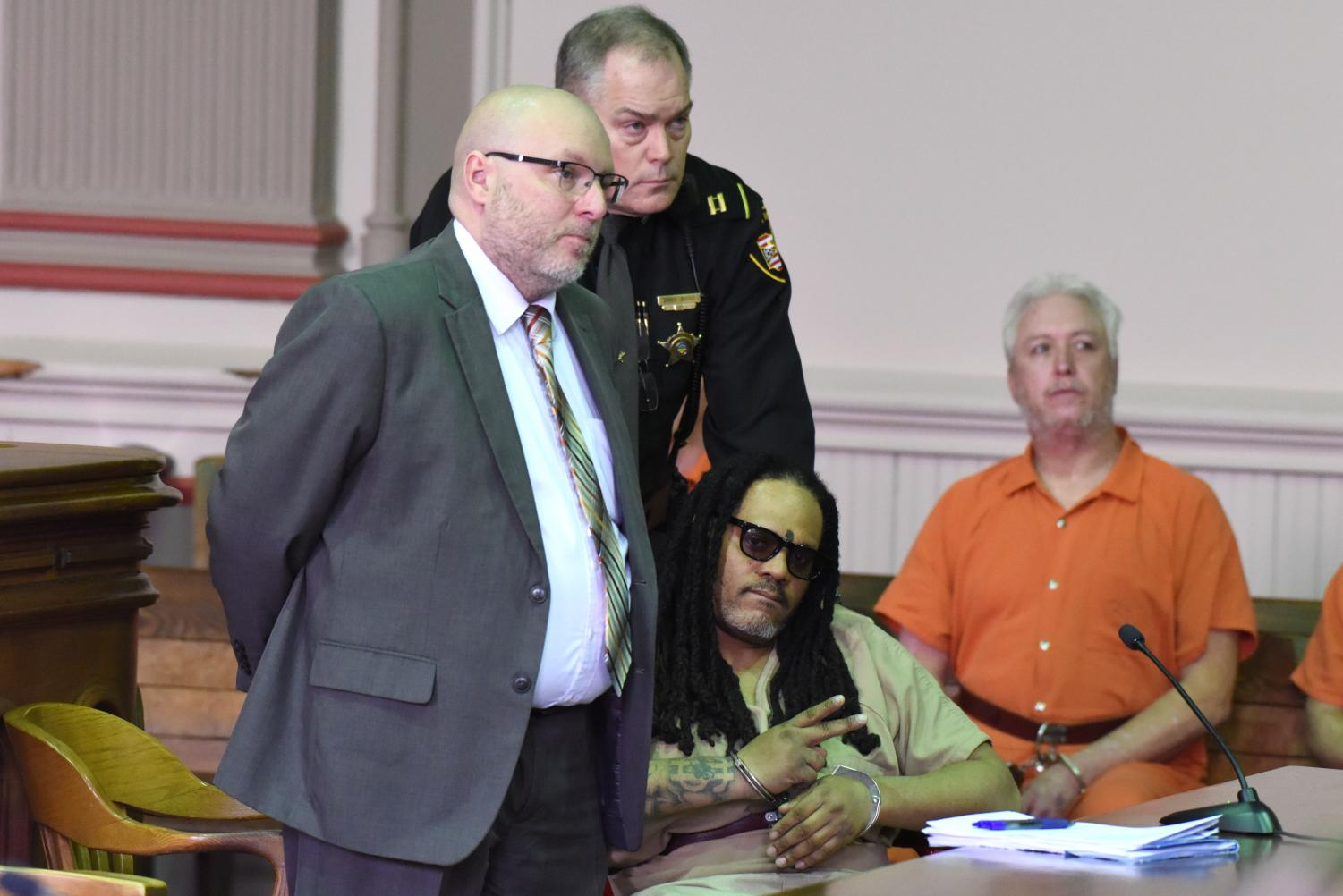 Gerald Draughn locks eyes with the camera during his arraignment in February.