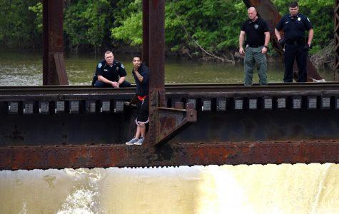 Negotiator talks man down from bridge