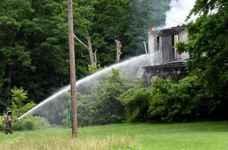 Firefighters+fighting+the+blaze+at+160+Dresden+Adamsville+Rd.+were+instructed+to+stay+on+the+outside+of+the+structure+as+it+was+too+hot+to+send+anyone+into+the+vacant+home.