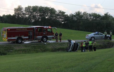 Driver rolls off roadway while avoiding SUV that blew stop sign, fled scene