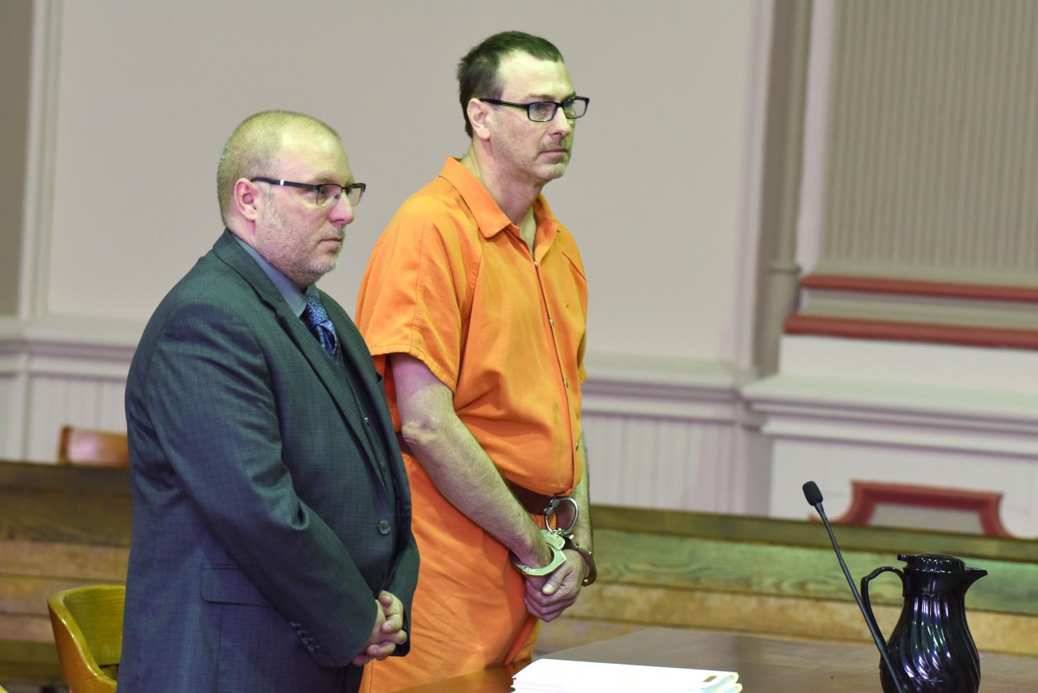 Larry Mitchell pleads guilty to reduced charges after being accused of raping his ex-wife during his hearing on June 3.