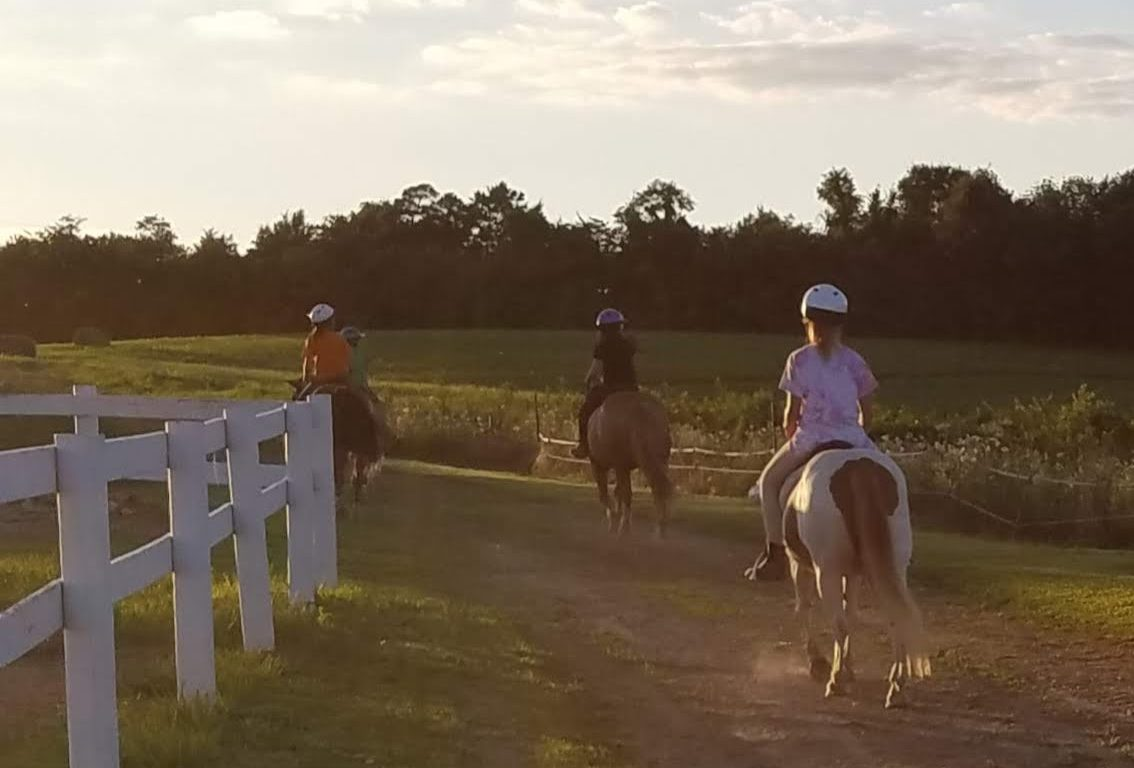 A group of students embarks on a trail ride at Breaking Free during an able-bodied riding lesson. | Photo provided by Courtney Blaney