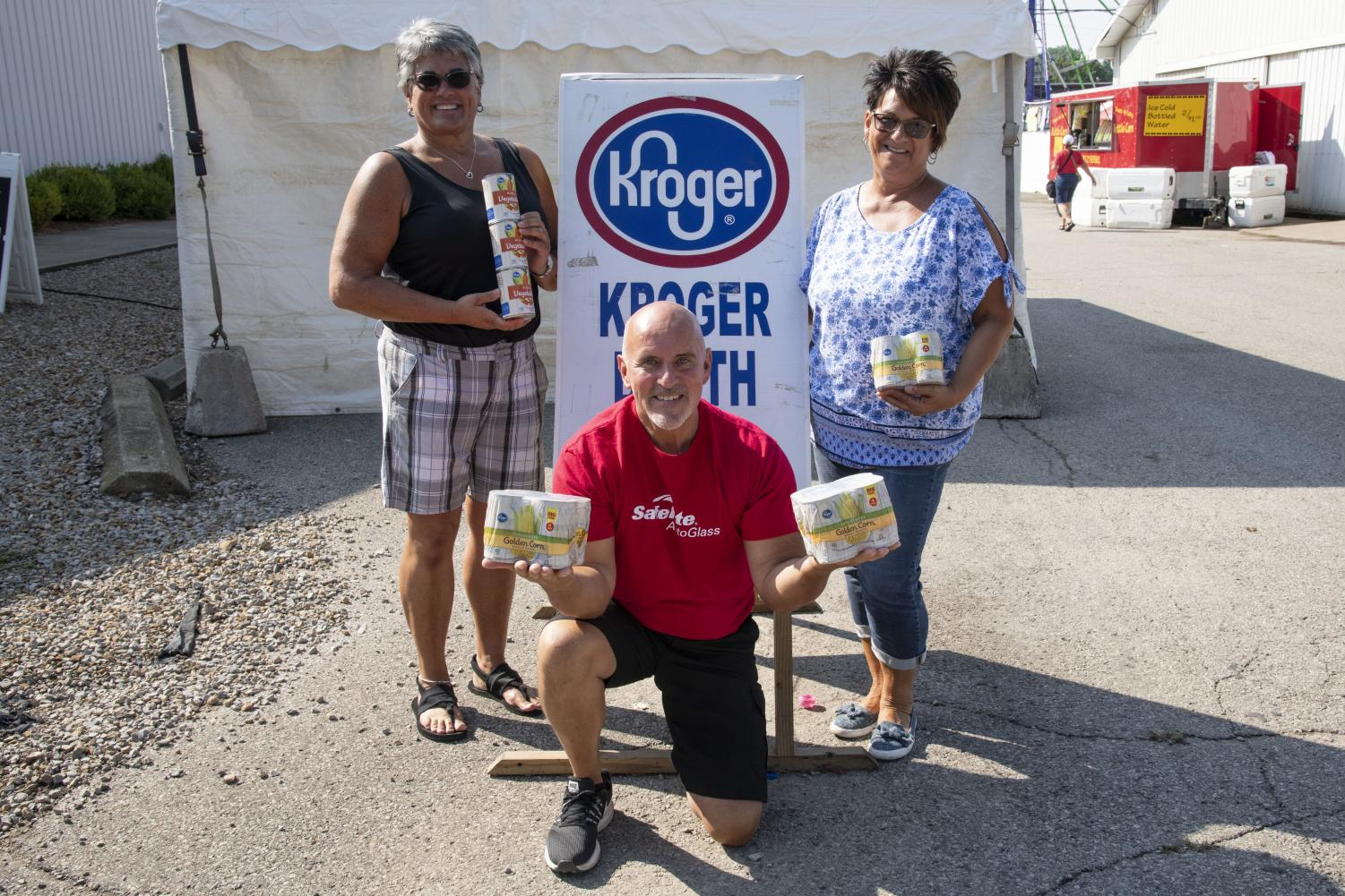 Pictured left to right are Marti King of Kroger, Al Morgan of Safelight AutoGlass and Keely Warden of Christ's Table.