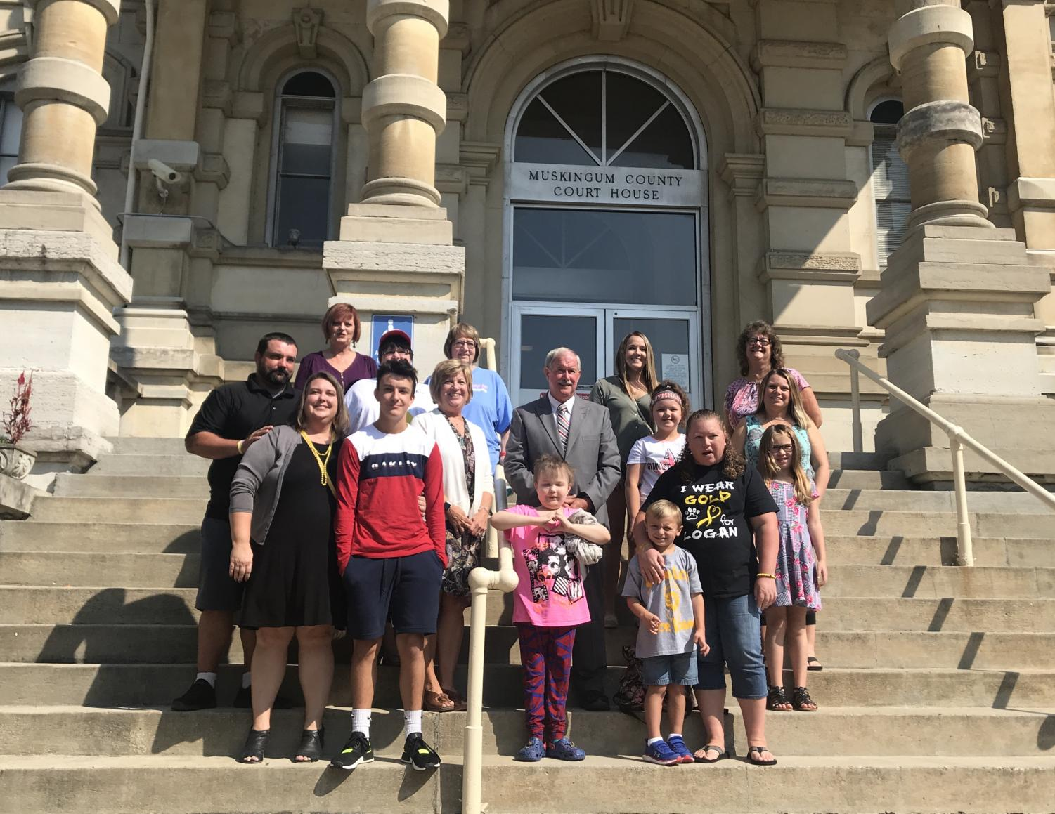 Five children that have previously been diagnosed with cancer were accompanied by their family members Thursday morning as the Muskingum County Commissioners presented them with proclamation to name September Childhood Cancer Awareness Month.
