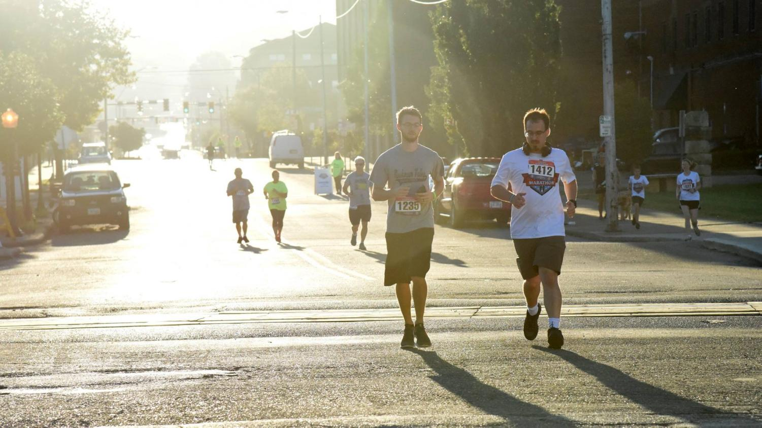 Runners Cameron Godfrey and Daniel Barr head toward the finish line during the 2018 5K race.