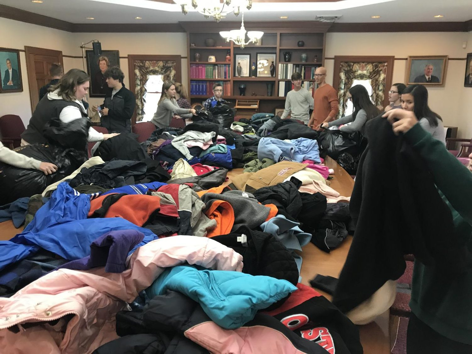 CYF members sorting through donated winter items at the conclusion of the 2018 CYF Winter Coat Drive | Photo provided by the Community Youth Foundation