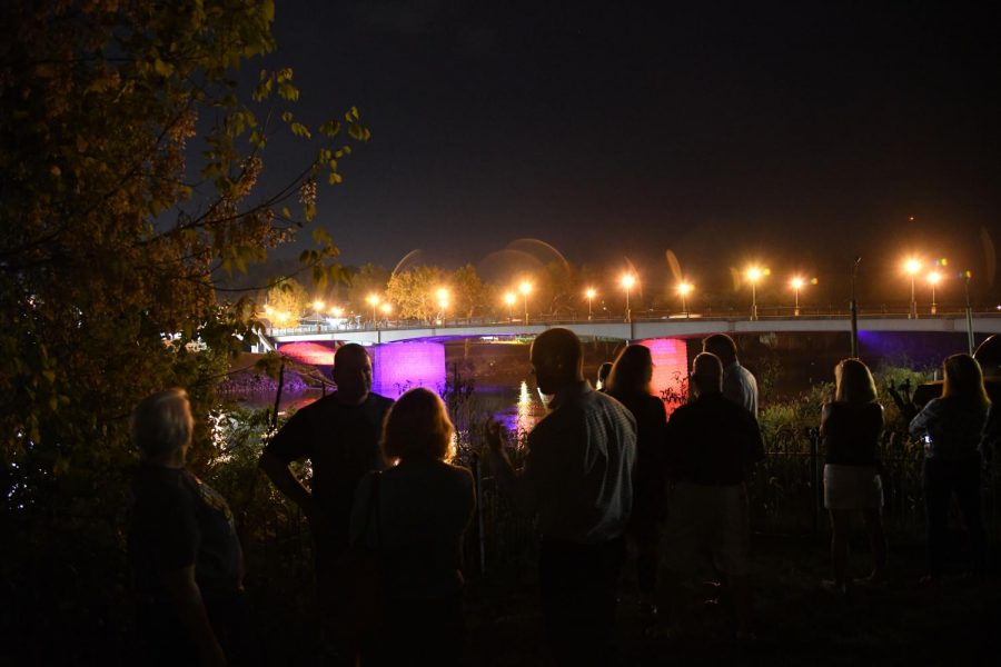 Community+members+involved+in+making+the+bridge+lighting+possible+gathered+at+Restoration+Park+Tuesday+evening+to+view+the+lights.