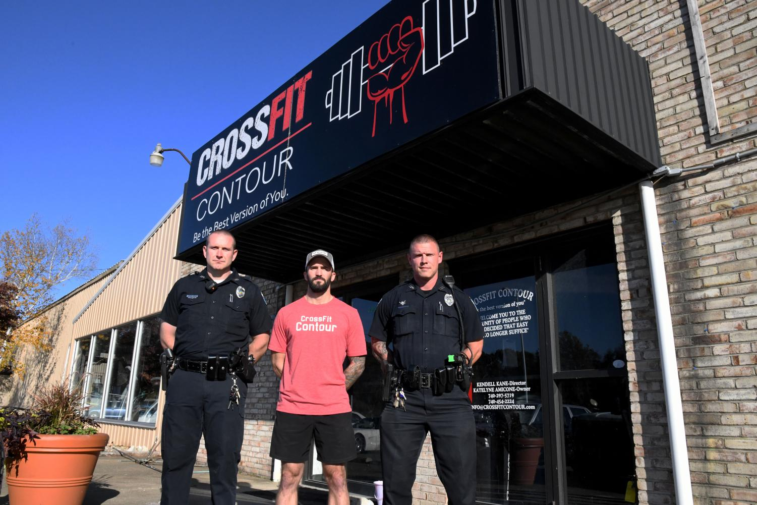 CrossFit Contour Coach Kendall Kane (center) has volunteered his gym and equipment for the Nov. 2 event organized by Zanesville Police Department Patrolmen Ryan Harris (left) and Bryan Wolfe (right).
