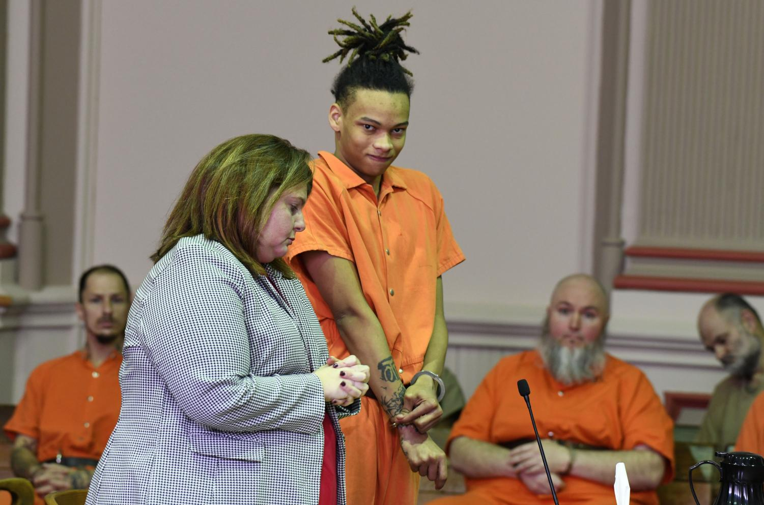 Jamal Mayle readjusts his handcuffs in court before being sentenced to 10 years in prison.