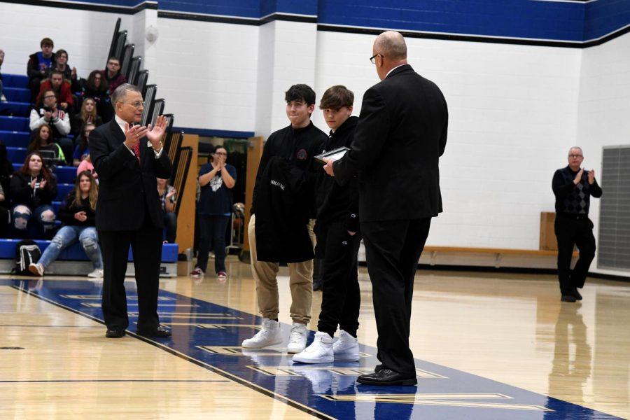 Mayor Don Mason and Police Chief Tony Coury present Ryan Murphy (left) and Nathan Smith (right) with Life Saving Awards.