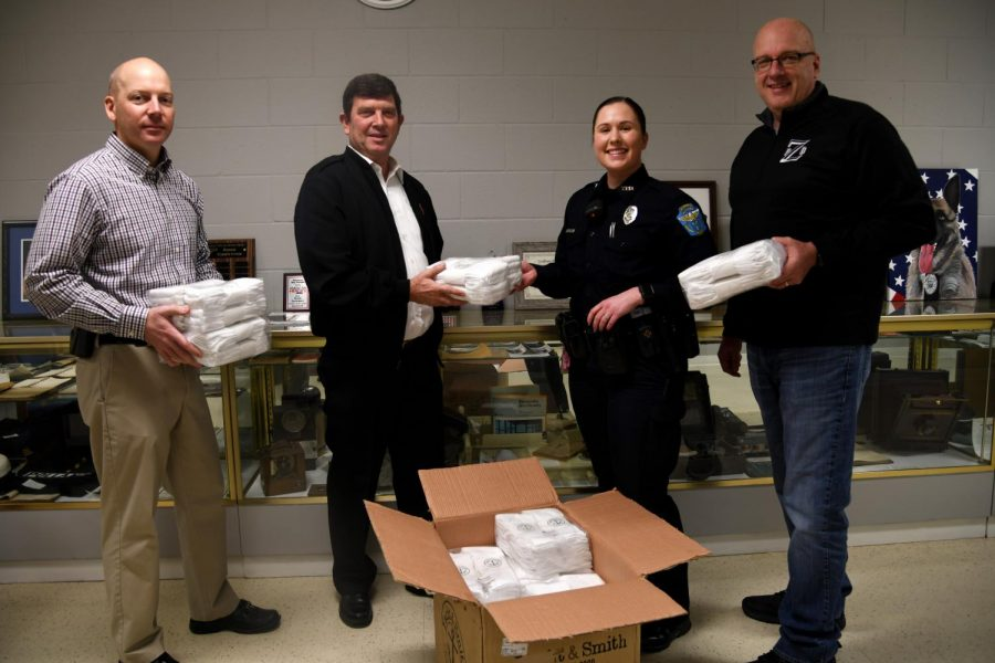 From left to right: Captain Scott Comstock with ZPD, Envoy George Bates with the Salvation Army, patrol officer Alexis Glaub with ZPD and Chief Tony Coury with ZPD.